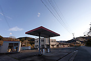 A gas station in the abandoned village of Tsushima in Fukushima, Japan. Friday May 4th 2012. After the explosions at the daichi nuclear plant caused by the March 11th 2011 earthquake and tsunami, high levels of radiactive contamination in this village has made it uninhabitable.