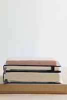 Stack of books and paper stationery studio shot