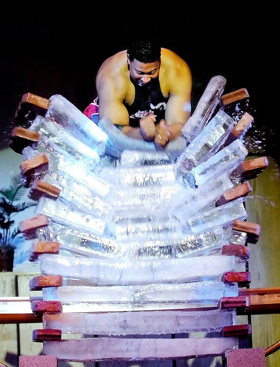 022507     Brian Leddy.Tim Spigner of the Power Team breaks 10 blocks of ice during a performace at First Baptist Church on Sunday night. The Power Team is Dallas, Tex. based Christian ministry aimed at spreading the message of the bible through its use of power, strength and speed.