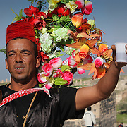 Costumed Jordanian hibiscus tea seller, Umm Qais (Gadara), Jordan (December 2007)
