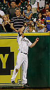 July 25, 2012; Houston, TX, USA; Houston Astros right fielder Brian Bogusevic (19) catches a fly ball at the wall against the Cincinnati Reds during the sixth inning at Minute Maid Park. Mandatory Credit: Thomas Campbell-US PRESSWIRE