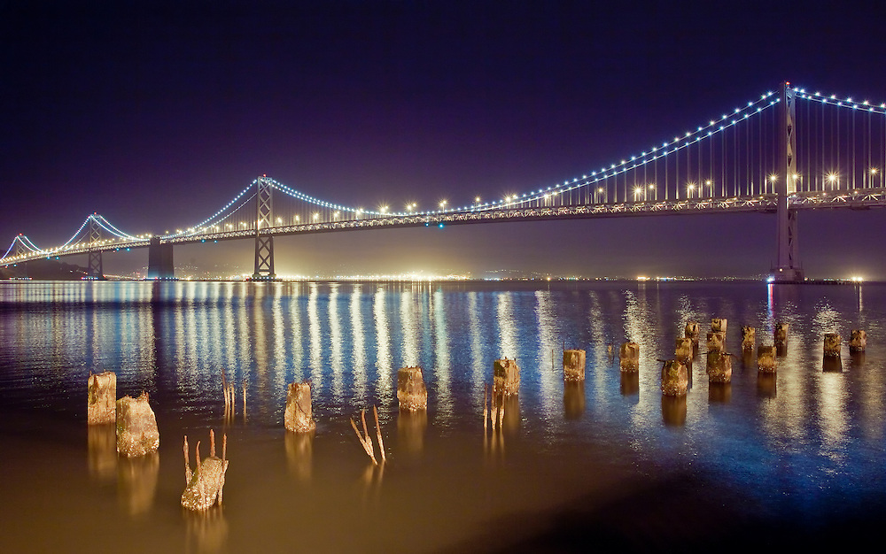 long exposure night shot of the bay bridge from san francisco to oakland