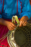 A Tarahumara Indian woman weaving a basket,  Uno Lodge, Copper Canyon (near San Rafael), Mexico