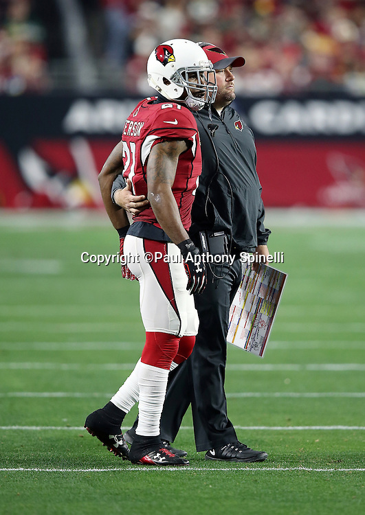 Arizona Cardinals defensive coordinator James Bettcher stands with Arizona Cardinals cornerback Patrick Peterson (21) during a break in the action during the NFL NFC Divisional round playoff football game against the Green Bay Packers on Saturday, Jan. 16, 2016 in Glendale, Ariz. The Cardinals won the game in overtime 26-20. (©Paul Anthony Spinelli)