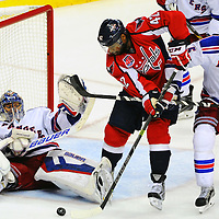 06 May 2015:  Washington Capitals right wing Joel Ward (42) has his shot stopped by New York Rangers goalie Henrik Lundqvist (30) at the Verizon Center in Washington, D.C. where the Washington Capitals defeated the New York Rangers, 2-1 in the fourth game of the Eastern Conference Second Round series of the Stanley Cup Playoffs.  (Photograph by Mark Goldman - Goldminephotos)