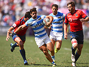 Spanish player Rodrigo Etchart breaks a tackle in the game Argentina vs Spain during the Cathay Pacific/HSBC Hong Kong Sevens festival at the Hong Kong Stadium, So Kon Po, Hong Kong. on 8/04/2018. Picture by Ian  Muir.