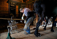 Scott Sanders, demonstrating horse shoeing the the Livery Stable which is part of a 30 building re-creation based on Wisconsin villages a century ago. ..Horse Drawn Days was held Saturday, June 12, 2010 at Stonefield Historic Site near Cassville, Wisconsin.