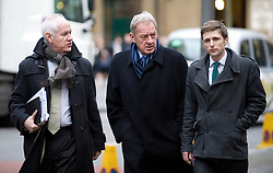 © Licensed to London News Pictures. 23/01/2012. London, UK.  Milan Mandaric (centre) arriving at Southwark Crown Court on January 23rd, 2012. Mandaric faces two counts of cheating the public revenue. Charges relate to the payment of $295k from Milan Mandaric to Harry Redknapp via a bank account in Monaco, evading tax and national insurance, while the pair were at Portsmouth Football Club Photo credit : Ben Cawthra/LNP