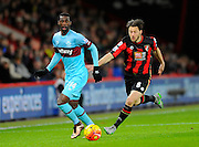 West Ham Utd midfielder Pedro Mba Obiang and AFC Bournemouth midfielder Harry Arter during the Barclays Premier League match between Bournemouth and West Ham United at the Goldsands Stadium, Bournemouth, England on 12 January 2016. Photo by Graham Hunt.
