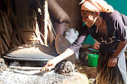 Making injera on an open fire. Injera is a large sourdough flatbread which is extremely popular and accompanies most meals in Ethiopia.