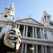 An Anonomy, with the classec V mask in front of St PAul's Cathedral