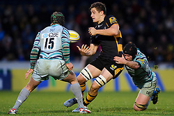 Wasps replacement (#20) Sam Jones is tackled by Leicester Flanker (#7) Julian Salvi as Full Back (#15) Mathew Tait defends during the second half of the match - Photo mandatory by-line: Rogan Thomson/JMP - Tel: Mobile: 07966 386802 25/11/2012 - SPORT - RUGBY - Adams Park - High Wycombe. London Wasps v Leicester Tigers - Aviva Premiership.