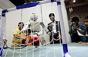 Fujitsu's HOAP-3 robot kicks a soccer ball at Robo Japan 2008 in Yokohama, Japan on Saturday 09 October 2008.