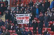 Charlton fans show their feelings towards the club owners during the Sky Bet Championship match between Charlton Athletic and Middlesbrough at The Valley, London, England on 13 March 2016. Photo by Andy Walter.
