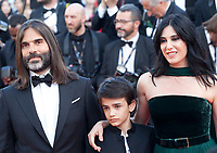 Khaled Mouzanar, Zain Alrafeea, director Nadine Labaki, at the Capharnaüm (Cafarnaúm)  gala screening at the 71st Cannes Film Festival, Thursday 17th May 2018, Cannes, France. Photo credit: Doreen Kennedy