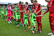 The mascots during the respect handshake during the Vanarama National League match between Forest Green Rovers and Barrow at the New Lawn, Forest Green, United Kingdom on 1 October 2016. Photo by Shane Healey.