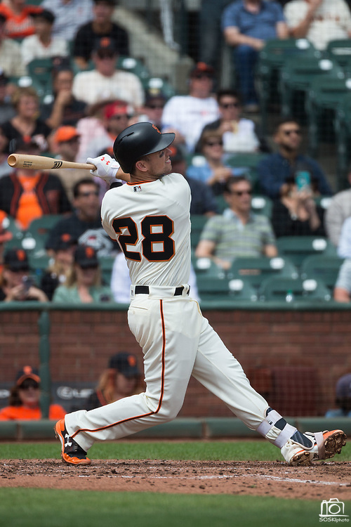 San Francisco Giants first baseman Buster Posey (28) makes contact with a Colorado Rockies pitch at AT&T Park in San Francisco, California, on September 20, 2017. (Stan Olszewski/Special to S.F. Examiner)