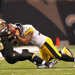 Oct 31, 2010; New Orleans, LA, USA; Pittsburgh Steelers linebacker LaMarr Woodley (56) tackles New Orleans Saints tight end David Thomas (85) during the first half at the Louisiana Superdome. Mandatory Credit: Derick E. Hingle..