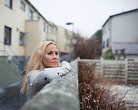 Young woman standing in the snow