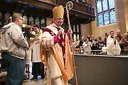 Bishop Salvatore R. Matano enters Sacred Heart Cathedral during the Chrism Mass on Tuesday, March 31, 2015.