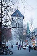 To kirketårn, to tårn, Vår Frue kirke og i bakgrunnen Nidarosdomen.  Trondheim sentrum og gågata Nordre gate.