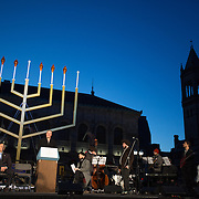 "Governor Charlie Baker and other leaders present a Hanukkah ceremony in Copley Square on December 6, 2015 in Boston, Massachusetts. Also pictured are various stops at the ""8 Windows, 8 Nights"" displays around Boston. (Photo by Elan Kawesch)"