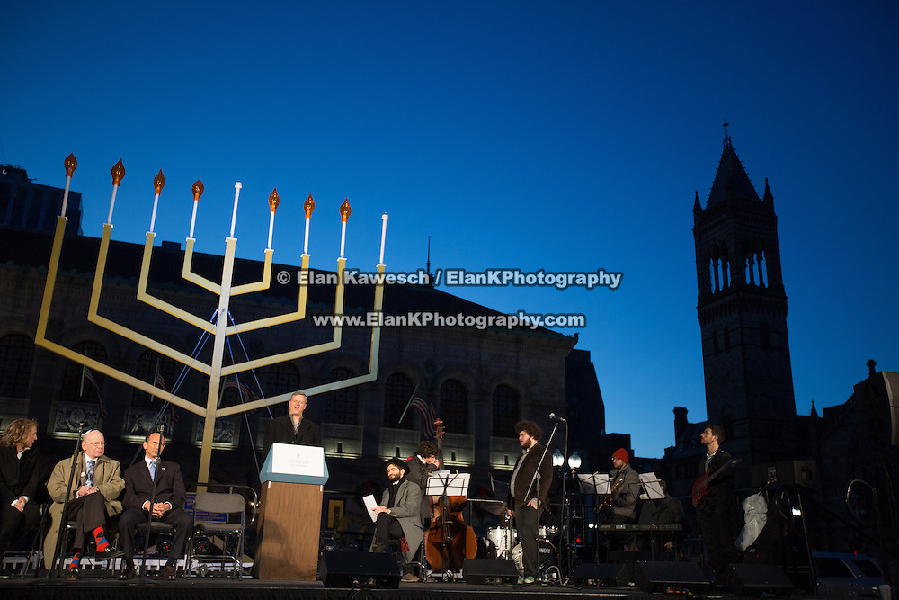 """Governor Charlie Baker and other leaders present a Hanukkah ceremony in Copley Square on December 6, 2015 in Boston, Massachusetts. Also pictured are various stops at the """"8 Windows, 8 Nights"""" displays around Boston. (Photo by Elan Kawesch)"""
