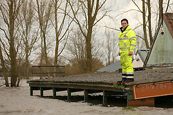 © Licensed to London News Pictures. 26/02/2014. Somerset Levels, UK Floodwater in Burrowbridge, Somerset today 26th February 2014. Photo credit : Jason Bryant/LNP