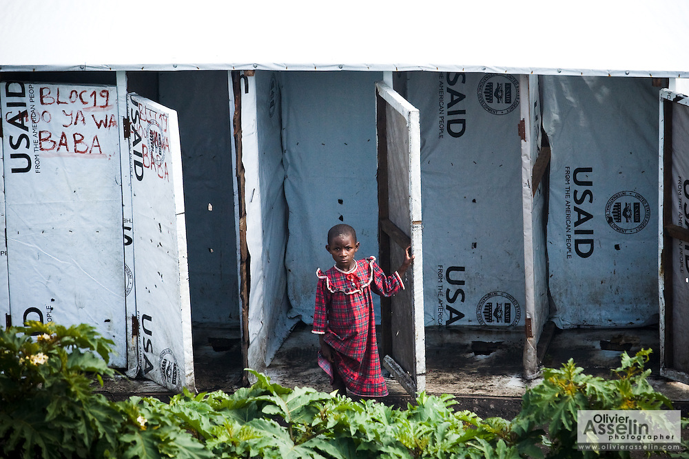 An internally displaced girl comes out of latrines in the Kibati IDP camp on the outskirts of Goma, Eastern Democratic Republic of Congo on Friday December 12, 2008