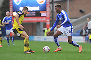 Gboly Ariyibi (28) of Chesterfield FC and Tyler Hornby-Forbes (12) of Fleetwood Town  during the Sky Bet League 1 match between Chesterfield and Fleetwood Town at the b2net stadium, Chesterfield, England on 26 March 2016. Photo by Ian Lyall.