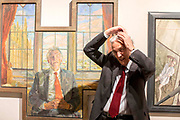 UNITED KINGDOM, London: 08 May 2019 <br /> MP Bruce Grocott, Baron Grocott PC, fixes his hair as he stands next to his portrait painted by Daphne J. Todd at the launch of The Royal Society of Portrait Painters' annual exhibition at The Mall Galleries, London. <br /> The exhibition consists of faces both famous and not-so famous and is a celebration of the very best in contemporary portraiture nationally and internationally.<br /> Rick Findler