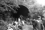 Ravers chilling by a tunnel, Ashton Court Festival, Bristol, UK, 1995.