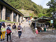 Visitors arrive to the main entrance to Machu PIcchu, near Aguas Calientes, Peru.