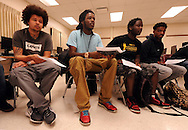 Minneapolis , MN -  April 27, 2015 -  (L toR) Marcus Hennen,Shaded Cole, Marcellus Ellis and Alaon Mitchell listen to the discussion during the Black Male Student Achievement meeting South High School on Monday, April 27, 2015. Photo by Johnny Crawford/ Johnny Crawford Photography