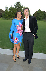ELLA KRASNER and ALEX McLEAN at 'Horticouture' a charity fashion show to raise funds for Tommy's, the baby charity and The Royal Botanic Gardens, Kew held at Kew on 12th May 2005.<br />
