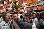 JAPAN, Tokyo : Local residents carry a portable shrine or &quot;mikoshi&quot; during the Sanja Matsuri festival in Tokyo on May 15, 2016.<br />