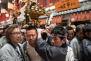 JAPAN, Tokyo : Local residents carry a portable shrine or &quot;mikoshi&quot; during the Sanja Matsuri festival in Tokyo on May 15, 2016.<br /> Over 1.5 million people flocked to Tokyo's Asakusa district during the three-day-long annual festival, which heralds the coming of summer in the Japanese capital.