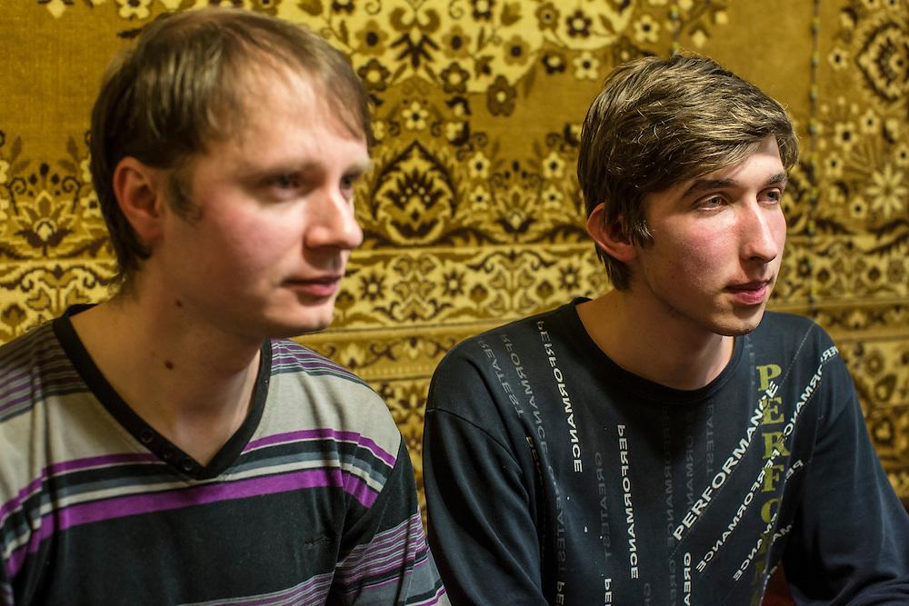 LUHANSK, UKRAINE - MARCH 14, 2015: Aleksandr Kryukov, left, and Pavel Pavlov at Aleksandr's grandmother's house where he lives in Luhansk, Ukraine. CREDIT: Brendan Hoffman for The New York Times