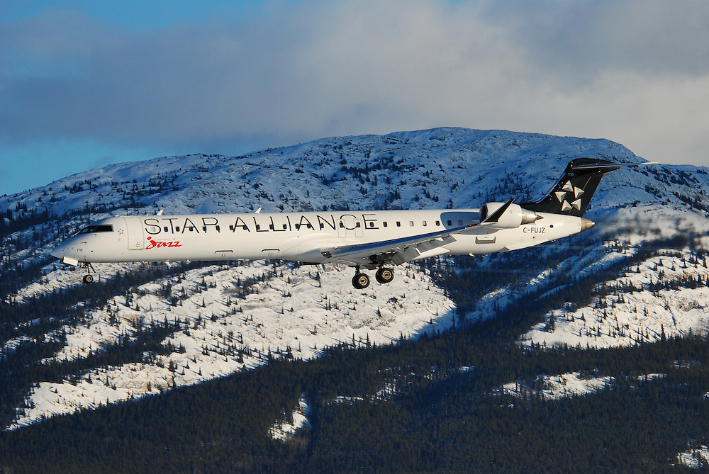 Bombardier CRJ-705 Regional Jet in Star Alliance livery on approach into Whitehorse, Yukon.