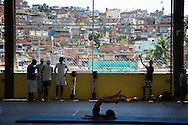 Practicing and hanging out between classes, Complexo do Alema?o ..The government built Vila Oli?mpica building on the edge of the 'Complexo' provides a temporary home for AfroReggae until their space above to the residents association on the main street is ready.  ..Nicola Dracoulis, Rio de Janeiro, Brazil, September 2006.