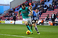 Grant Hanley of Blackburn Rovers breaks away from Martyn Waghorn of Wigan Athletic. Skybet football league championship match , Wigan Athletic v Blackburn Rovers at the DW Stadium in Wigan, Lancs on Saturday 17th Jan 2015.<br /> pic by Chris Stading, Andrew Orchard sports photography.