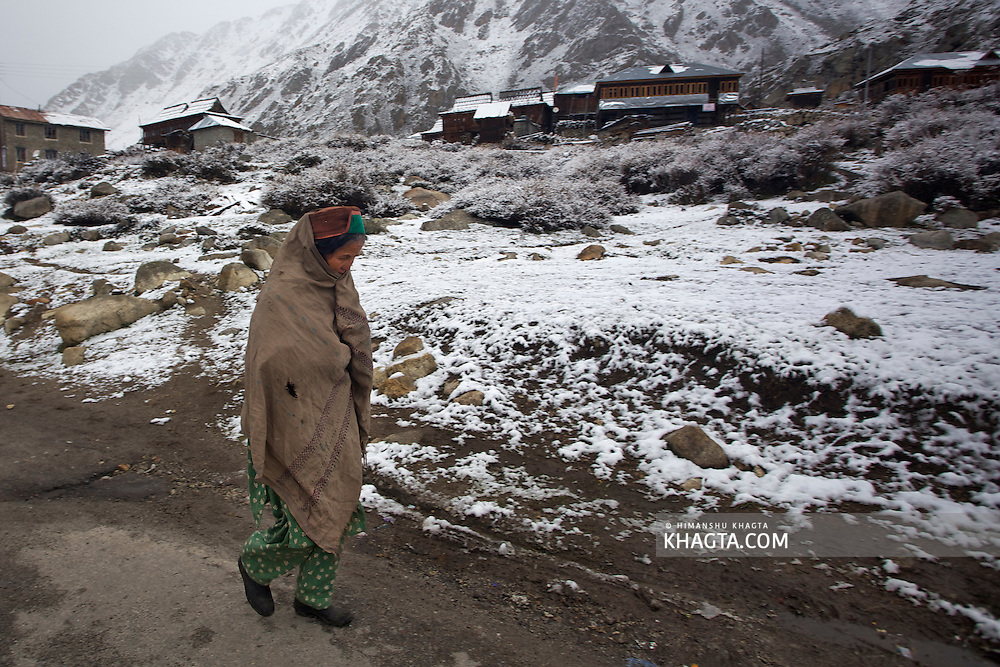 A lady from the Himalayan Village of Chitkul, Kinnaur, Himachal Pradesh walking to her home in immense cold in the month of April