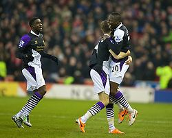 STOKE-ON-TRENT, ENGLAND - Sunday, January 12, 2014: Liverpool's Aly Cissokho celebrates scoring the first goal against Stoke City during the Premiership match at the Britannia Stadium. (Pic by David Rawcliffe/Propaganda)