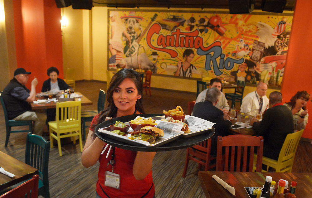 gbs042617a/BUSINESS -- April Toledo of Rio Rancho serves a meal at the new Cantina Rio restaurant in the Santa Ana Star Casino on Wednesday, April 26, 2017. (Greg Sorber/Albuquerque Journal)
