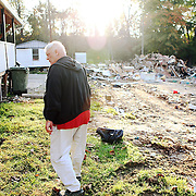 Hank Ridge, owner of the Holly Acres mobile home park, looks over a disputed trailer.  The flooding of the park lead to the demolition of dozens of trailers at the park.  Many residents tried unsuccessfully to file an injunction to stave off demolition of several trailers that were disputed as being salvageable. For The News & Messenger (Manassas, VA)