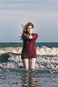 a woman with a gun in the water
