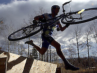NEWS&GUIDE PHOTO / BRADLY J. BONER.--- hurtles an obsticle Satruday in the cyclocross course in Teton Village.