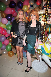 Left to right, EMMA HILL Creative Director at Mulberry and Singer NICOLA ROBERTS from Girls Aloud at a party hosted by Mulberry during London fashion Week 2009 at Claridge's Hotel, Brook Street, London on 20th September 2009.