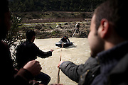 Members of the Free Syrian Army entering Syria from Turkey by a improvised river crossing near Al Janoudiyah, Province of Idlib, Syria.