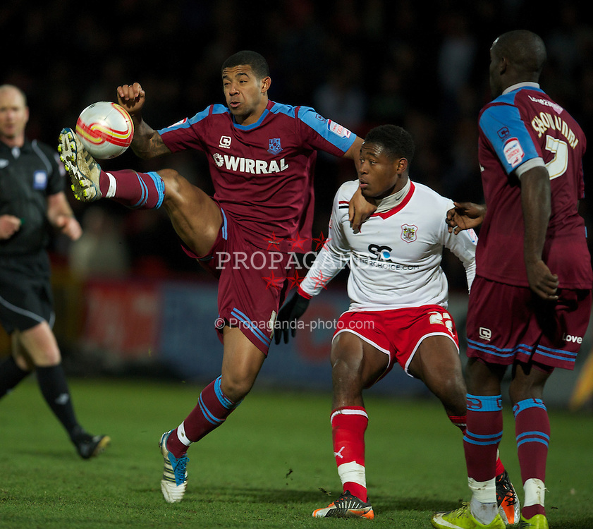 STEVENAGE, ENGLAND - Saturday, December 17, 2011: Tranmere Rovers' Joss Labadie in action against Stevenage's Dino Maamria during the Football League One match at Broadhall Way. (Pic by David Rawcliffe/Propaganda)